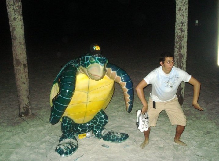 Joel Ebel on Beach with Turtle.jpg